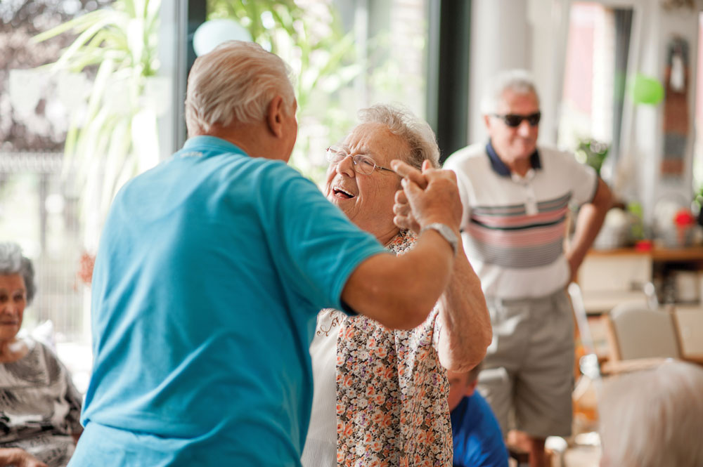 Park Louisville - Memory Care - Male and female memory care residents share a dance in the activity room